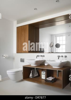 Two washbasins on unit in modern bathroom - Stock Photo