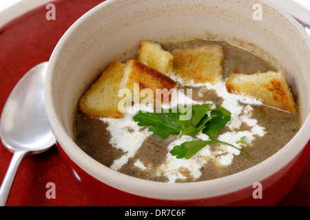 Homemade Cream Of Mushroom Soup In A Bowl With Croutons And Parsley Stock Photo