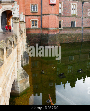 Gatehouse, & flooded moat of Hampton Court Palace filled deep with water after an unusually long spell of wet weather. - Stock Photo