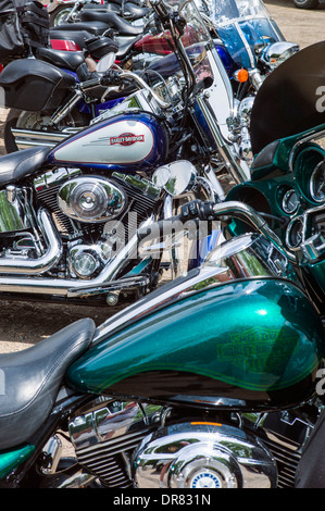 Harley Davidson motorcycles lined up on a sunny clear summer day - Stock Photo