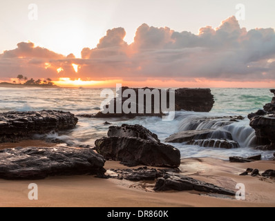 Sunrise over the ocean at Sandy Beach in Oahu, Hawaii - Stock Photo