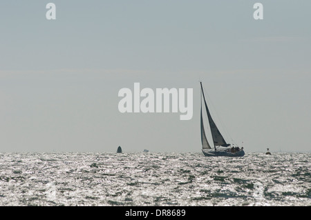 Yacht sailing on the Solent off Cowes on the Isle of Wight, England. - Stock Photo