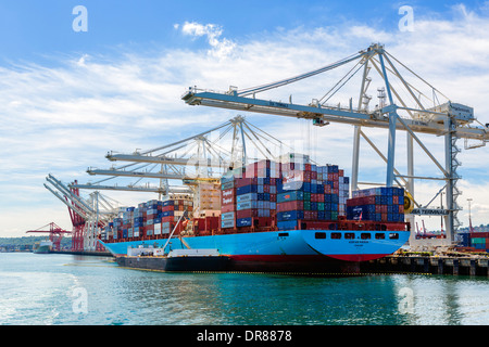 Container ship being unloaded in the Port of Seattle, Washington, USA - Stock Photo