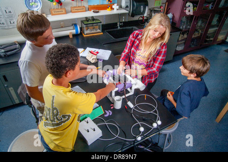 Multiracial middle school students in Mission Viejo, CA, test the remote operated vehicle (ROV) they built in their - Stock Photo