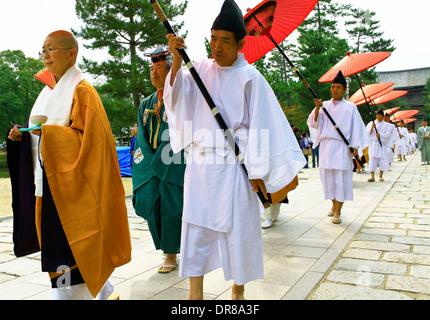 Shinto monks in Buddhist procession at Todaiji temple, Nara, Japan. - Stock Photo