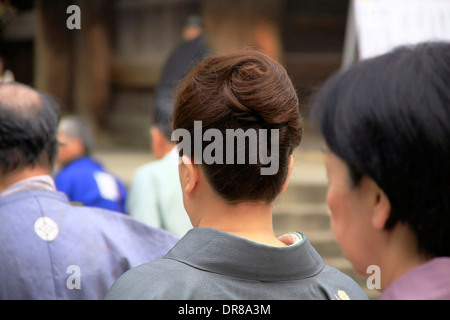 A stylish and perfectly coiffed Japanese woman in Buddhist procession at Todaiji temple, Nara, Japan. - Stock Photo