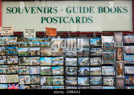 Postcards for sale outside a souvenir shop in Kings Parade Cambridge UK - Stock Photo