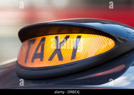 Illuminated London black taxi cab light, England, UK - Stock Photo