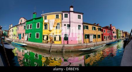 Burano, Venice - Multicoloured houses at a canal in Burano, Venice, Veneto, Italy - Stock Photo