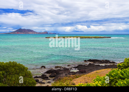 Popoia Island, commonly known as Flat Island, is a state seabird sanctuary off the coast of Kailua on Oahu, Hawaii - Stock Photo