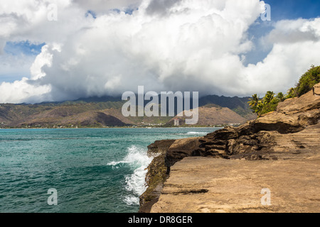 A view of Hawaii Kai and the Koolau Mountain Range from China Walls on the south shore of Oahu, Hawaii - Stock Photo