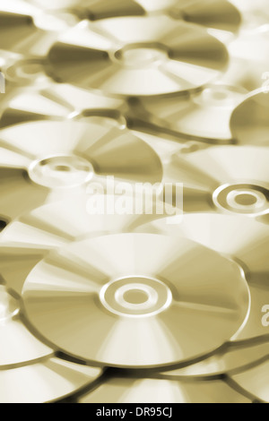 Many CD or DVD disks on each other - Stock Photo