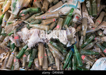 Empty Glass drinking bottles dumped for recycling in India - Stock Photo