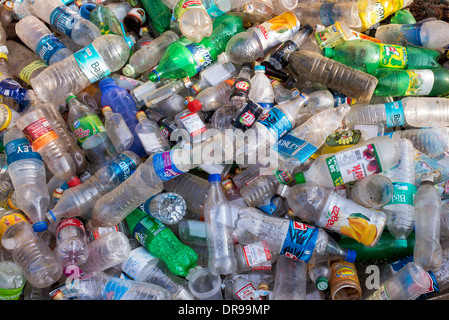 Empty Plastic drinking bottles dumped for recycling in India Stock Photo