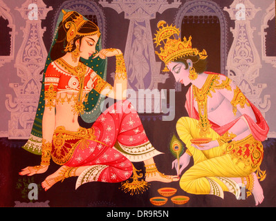 indian mural painting of Indian god Krishna and radha in a romantic scene - Stock Photo