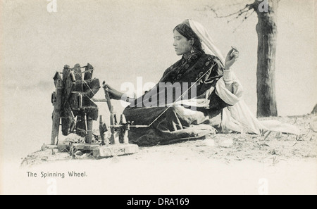 Woman spinning - India - Stock Photo