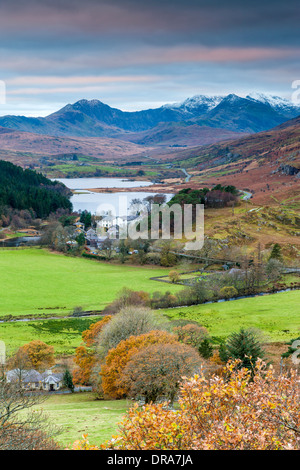 View above Capel Curig with Mount Snowdon in the background, Snowdonia National Park, Gwynedd, Wales, UK, Europe. - Stock Photo