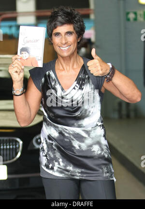 Fatima Whitbread holding a copy of her book 'Survivor' at the ITV studios London, England - 05.07.12 - Stock Photo