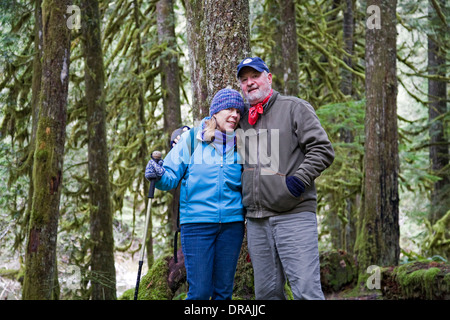Hikers in a temperate rain forest along the Lower Salmon River trail near Mount Hood, Oregon. - Stock Photo