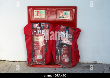 Fire extinguishers with covers - Stock Photo