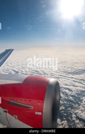 View through an aeroplane window whilst it is in flight. - Stock Photo