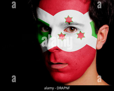 Flag of Burundi Painted on a Face of a Young Man - Stock Photo