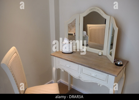 Dressing room table in a wig fitting boutique - Stock Photo