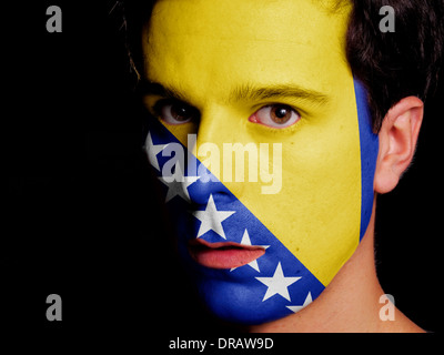 Flag of Bosnia and Herzegovina Painted on a Face of a Young Man - Stock Photo