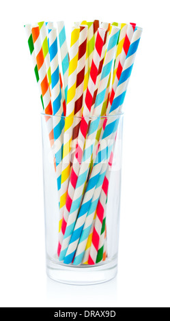 Striped drink straws of different colors in glass isolated on white background