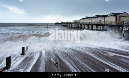 Waves breaking in high seas at Teignmouth Pier, Devon - Stock Photo