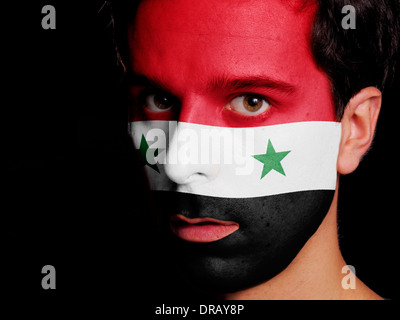 Flag of Syria Painted on a Face of a Young Man - Stock Photo