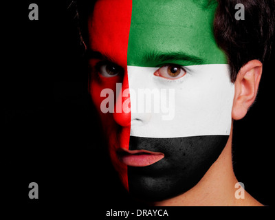 Flag of United Arab Emirates Painted on a Face of a Young Man - Stock Photo