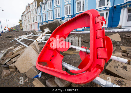 After a week of high tides, storm surges and storm force winds, the sea front promenade of Aberystwyth in Wales - Stock Photo