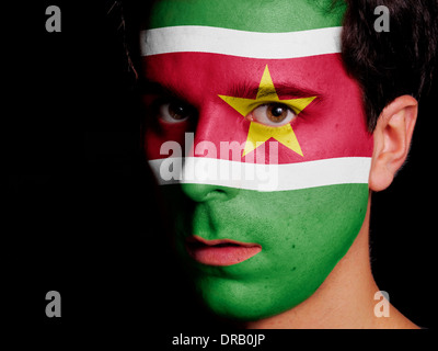 Flag of Suriname Painted on a Face of a Young Man - Stock Photo