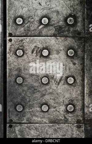 Black grunge metal plate texture with rivets as background - Stock Photo