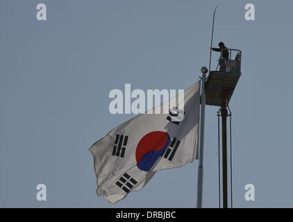 A worker attaches a lightning rod to a giant flag pole with the South Korean flag, outside the South Korean Unification - Stock Photo