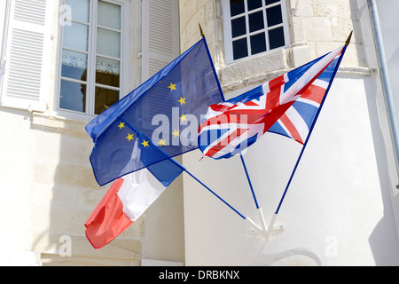 three flags fly together unity of france and england throught the european union