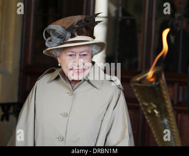 Britain's Queen Elizabeth II looks at the Olympic Flame at Windsor Castle, Berkshire.    Windsor, Berkshire - 10.07.12 Stock Photo