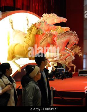 Hong Kong, China. 23rd Jan, 2014. Customers walk past New Year decorations at a shopping mall in Hong Kong, south - Stock Photo