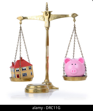 house and bank in balance concept for balance of finances - Stock Photo