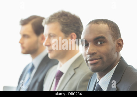 Businessmen sitting in office - Stock Photo
