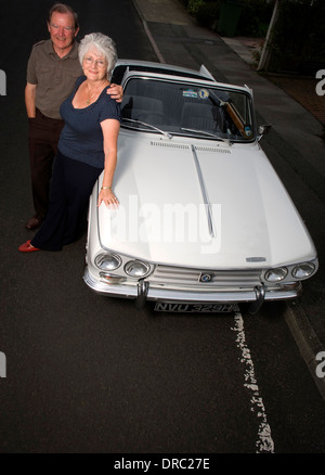 Derek & Brenda Jones with their Triumph Vitesse at their home in Cheadle,Greater Manchester. - Stock Photo