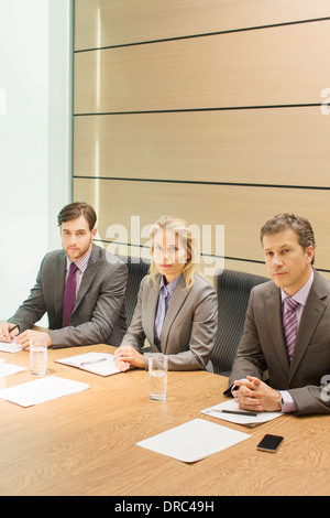 Business people sitting in meeting - Stock Photo