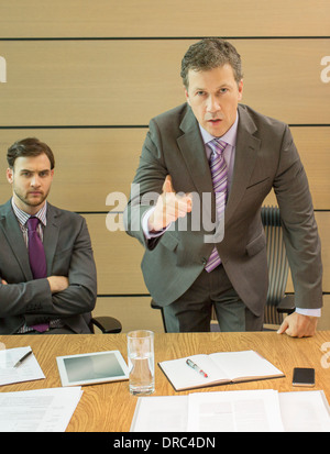 Businessman shaking his finger in meeting - Stock Photo