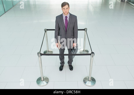 Businessman standing in roped-off square - Stock Photo