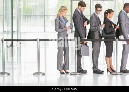 Business people waiting in line - Stock Photo