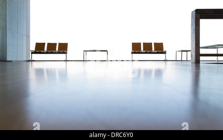 Chairs in empty lobby - Stock Photo