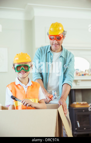 Father and son playing with construction toys - Stock Photo