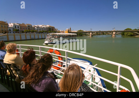 Sightseeing on the river Guadalquivir and Triana bridge, Seville, Region of Andalusia, Spain, Europe - Stock Photo