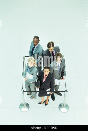 Business people standing in roped-off square - Stock Photo